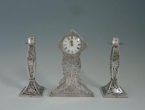 Three-piece silver clock set
