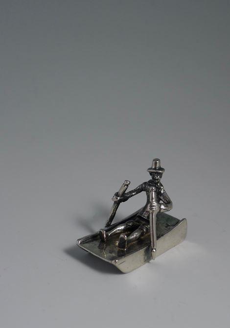 Miniature man on sled