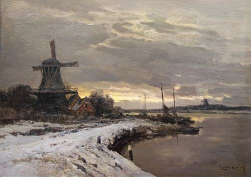 Winter landscape on a river with a mill