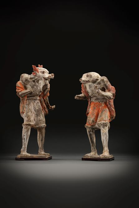 Pair of painted pottery figures